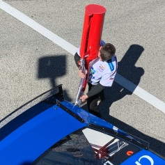 Here's a pit crew member putting gas in one of the cars.